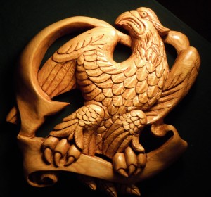 The eagle carving was sealed, stained and then coated with polyurethane varnish.